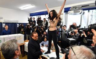 http://www.seguonews.it/il-tuo-tempo-e-scaduto-berlusconi-contestato-al-seggio-da-una-femen-a-torso-nudo