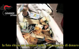 http://www.seguonews.it/mafia-e-droga-6-arresti-a-catania-indagato-fotografa-figlio-neonato-ricoperto-di-banconote