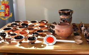 http://www.seguonews.it/gela-in-una-cassa-di-legno-nascondevano-decine-di-reperti-archeologici-denunciati-due-catanesi