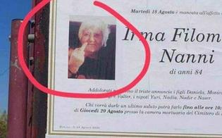 http://www.seguonews.it/donna-con-il-dito-medio-alzato-sul-manifesto-funebre-la-foto-di-filomena-diventa-virale-
