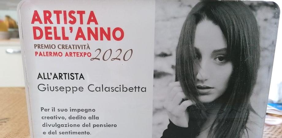 Premio artista dell'anno Artexpo al riesino Giuseppe Calascibetta: ha ritratto la giovane Giulia Danese